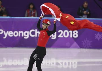 China's Wu wins 500m in world record time