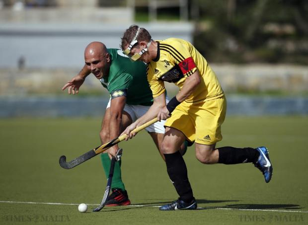 Players tussle for possession during the Challenge Cup hockey final between Qormi and Young Stars at Corradino on November 16. Photo: Darrin Zammit Lupi