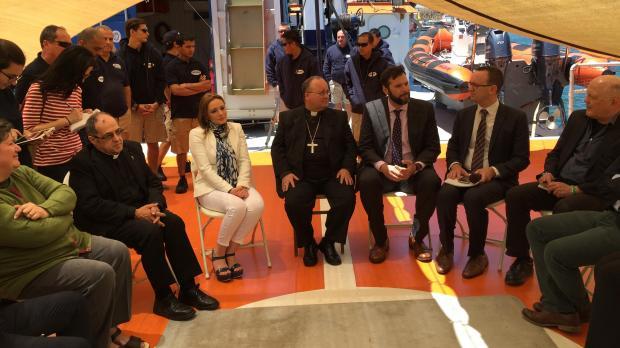 Archbishop Scicluna (centre) participating in the MOAS event. Photo: Darrin Zammit Lupi