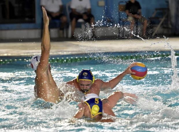 Boris Vapenski of St Julians is blocked by Steven Camilleri of Neptunes during the final match of the waterpolo league at Tal-Qroqq National Pool on August 29. Photo: Mark Zammit Cordina