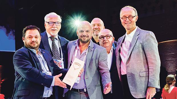 Receiving the Best Office in Europe Award (from left): Kevin Buttigieg, Frank Polzler, Jeffrey Buttigieg, Michael Polzler, Joseph Buttigieg and Walter Schneider.