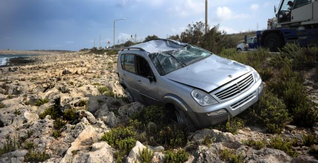 A 42 year-old woman from Gudja was slightly injured after her car overturned on the Coast Road in Bahar ic-Caghaq and ended up on the rocks on September 3. She was driving towards St Andrew's when she lost control of the vehicle. Photo: Jason Borg