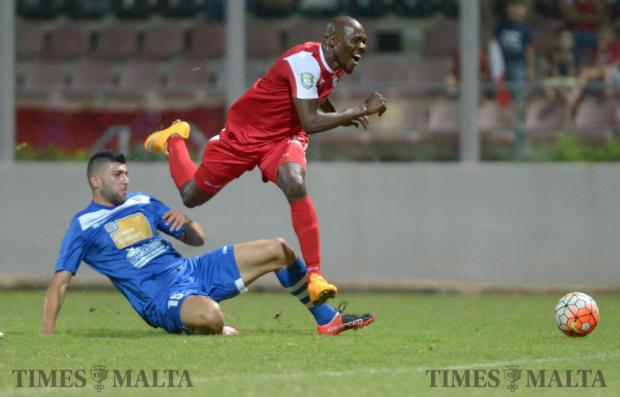 Mosta's Adrian Caruana (left) slides in to stop Alfred Effiong, of Balzan during their Premiership match at the Hibernians Stadium in Corradino on August 20. Photo: Matthew Mirabelli