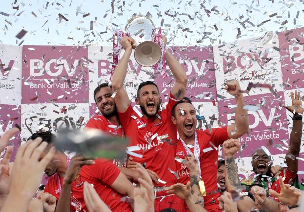 Valletta players celebrate with their trophy after winning the Premier League on April 21. Photo: Chris Sant Fournier