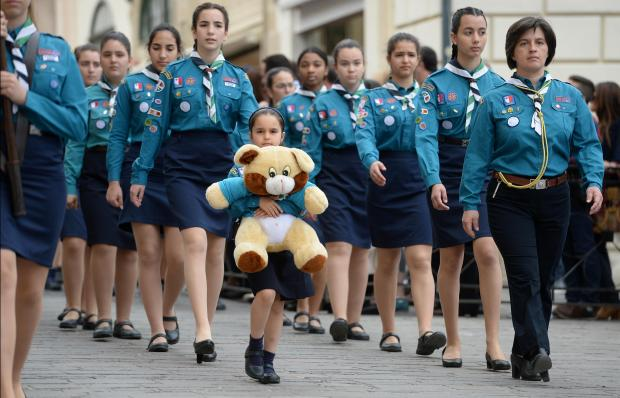 A young girl guide carries a teddy bear during the Annual Scout parade in Valletta on April 22. Photo: Matthew Mirabelli