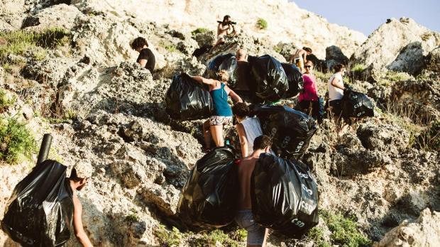 Young volunteers cleaned up Paradise Bay in July. Photo: Nik Caruana