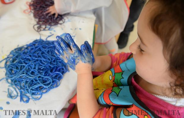 A child plays with spaghetti mixed with paint at a childcare centre in Naxxar on March 20. Photo: Matthew Mirabelli