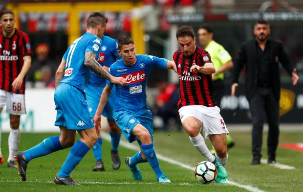 Giacomo Bonaventura (right) moves past Jorginho at the San Siro.