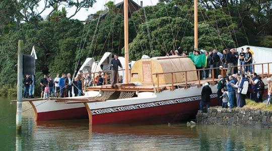 People gathering at the North Shore of Auckland for the official launch of a traditional Poylnesian canoe.
