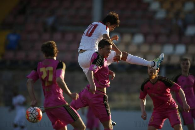 Valletta's Federico Falcone soars high over the B36 Torshavn's defence during the first leg of their Champions League first qualifying round football match at the Hibs Stadium in Corradino on June 28. Photo: Darrin Zammit Lupi