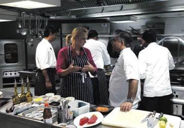 Lea Hogg with Vivek Singh.