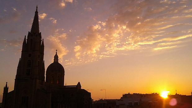 Sunset over Għajnsielem. Photo: Simon Mario Cachia