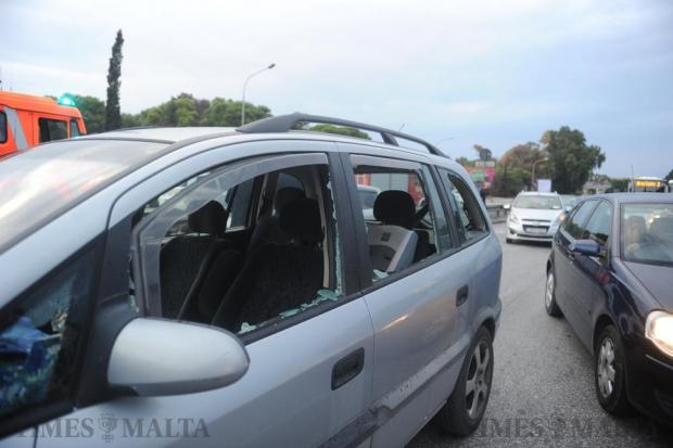 The shattered windows of an Opel car are seen after a bomb went off in a passing vehicle in Marsa on September 26. Three people were seriously injured, including the 37-year-old driver of the Opel. Photo: Steve Zammit Lupi