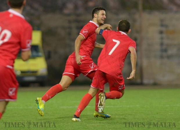Malta's Jean Borg celebrates with teammate Ryan Camenzuli after scoring the opening goal against Moldova during their UEFA U21 Championship group match at the Hibernians Stadium in Corradino on October 11. Photo: Matthew Mirabelli