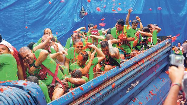 The Tomatina Festival, the protagonist of a kind of collective action painting, where a global crowd paints the town red. Photo: Shutterstock