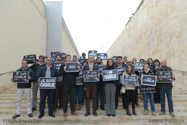 Journalist representatives from all newsrooms in Malta gather on the steps opposite the new Parliament on January 8, condemning the terrorist attack on the offices of the French satirical newspaper Charlie Hebdo in Paris, in which at least five journalists were killed. The journalists held 'Je Suis Charlie' placards and read a statement to condemn the attack. Photo: Matthew Mirabelli