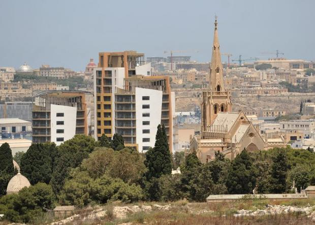 The Addolorata Cemetery chapel and a high-rise block are seen on May 25. Photo: Chris Sant Fournier