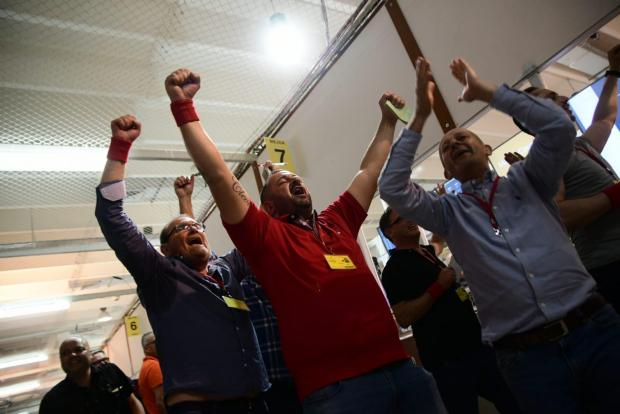 Labour supporters celebrate in the counting hall.