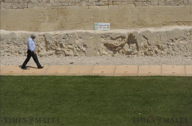 A man stays off the grass in Mdina ditch on May 28. Photo: Matthew Mirabelli