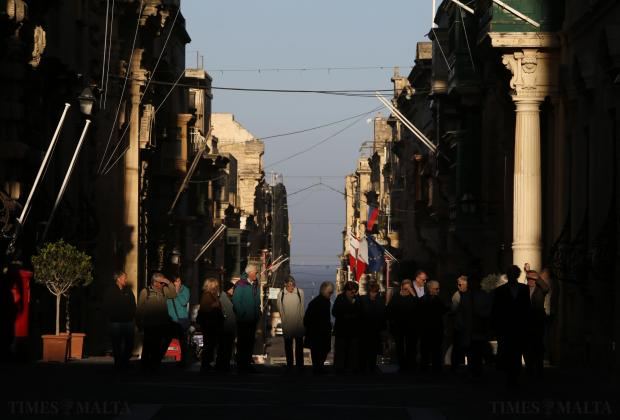 Tourists walk near government buildings in Valletta on January 11. Photo: Darrin Zammit Lupi