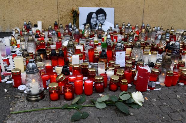 Candles and flowers are left for a tribute to murdered Slovak investigative reporter Jan Kuciak at Slovak National Uprising Square in Bratislava.