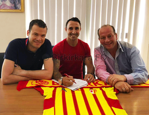 Michael Mifsud (centre) poses for a photo with Birkirkara president Frank Zarb (right) and technical director Michael Valenzia.