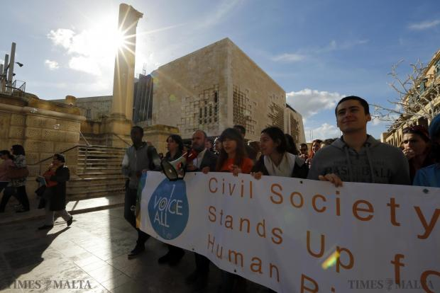 People demonstrate during an activity organised by various non-governmental organisations to mark International Human Rights Day in Valletta on December 14. Photo: Darrin Zammit Lupi