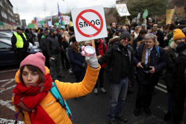 Protesters take part in the March for the Climate on the streets of Katowice.