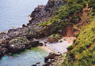Stairway sloping down to the sea in Zingaro Natural Reserve, Sicily, Italy.