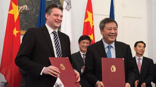 Kornad Mizzi presiding over the signing of a €320 million equity deal with Shanghai Electric in 2014.