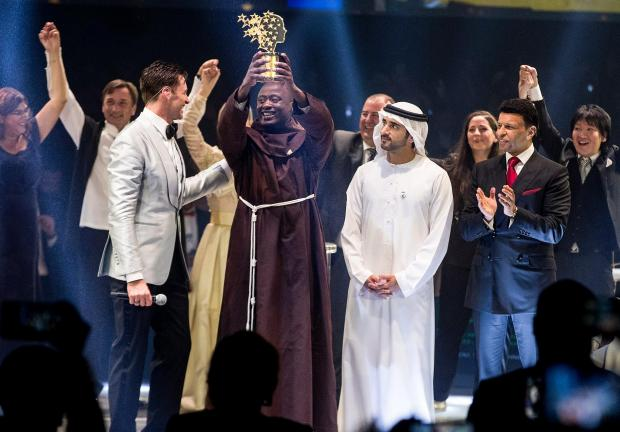 Peter Tabichi celebrates at the prize-giving ceremony. Photo: AFP