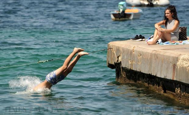 A man dives into the sea at Exiles in Sliema on August 1. Photo: Chris Sant Fournier