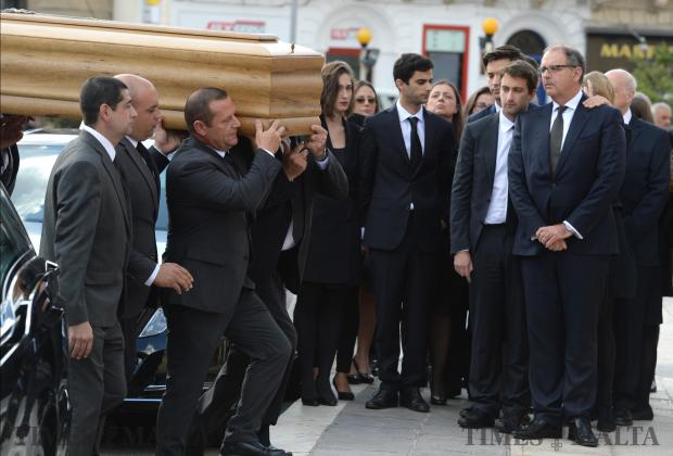 The body of murdered blogger Daphne Caruana Galizia is carried into the church of Mosta before her funeral ceremony, on November 3. Photo: Matthew Mirabelli
