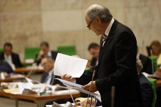 Finance Minister Edward Scicluna goes through his papers while presenting the 2016 Budget speech in parliament in Valletta on October 12. Photo: Darrin Zammit Lupi