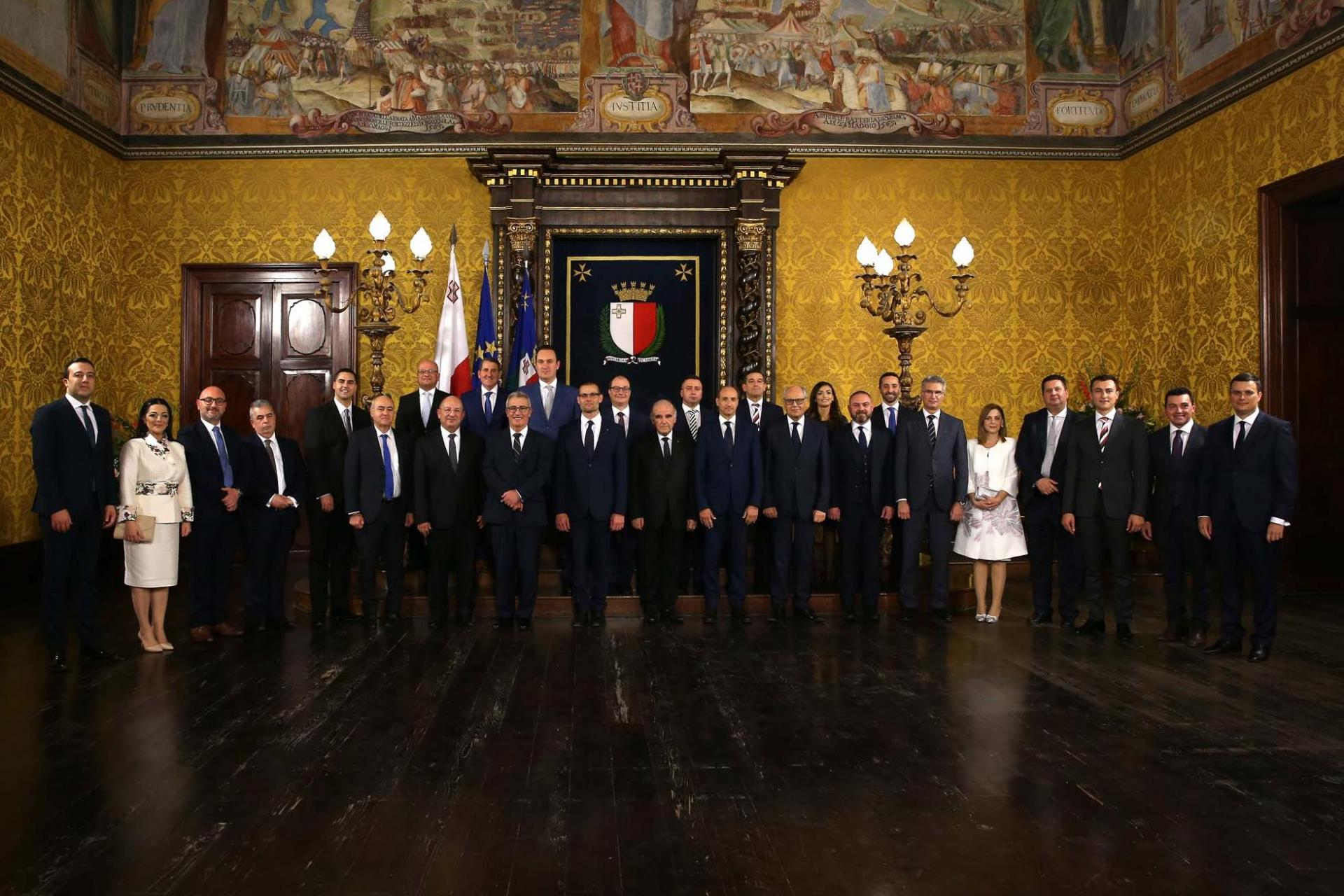 Robert Abela's new Cabinet join President George Vella in the traditional family portrait. Photo: DOI