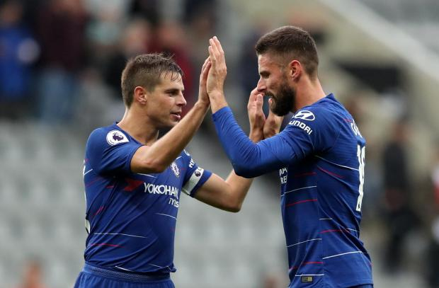 Chelsea's Cesar Azpilicueta and Olivier Giroud celebrate after the match.