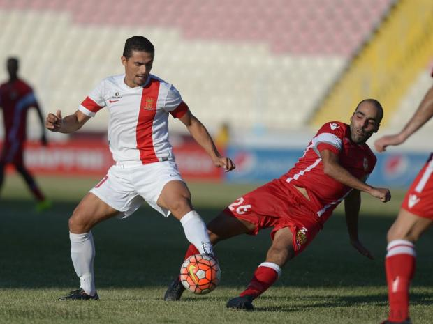 Naxxar's Armando Tarlazis Viera Dos Santos (right) tries to steal the ball from Valletta's Roderick Briffa at the National Stadium in Ta'Qali on September 27. Photo: Matthew Mirabelli
