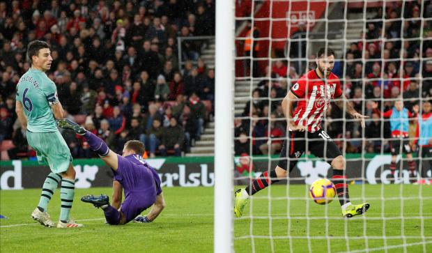 Charlie Austin scores Southampton's winner against Arsenal.