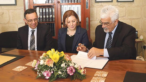 Signing the restoration agreement: Gozo Minister Justyne Caruana flanked by the Gozo Ministry's Permanent Secretary John Borg (left) and Wirt Għawdex secretary Giovanni Zammit. Photos: Charles Spiteri