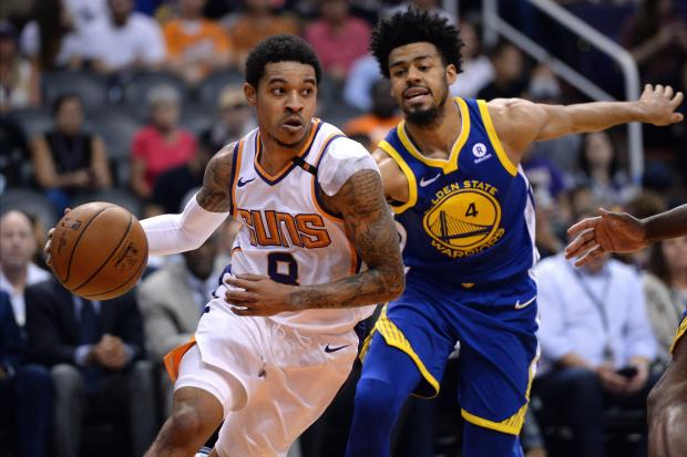 Phoenix Suns guard Tyler Ulis (8) dribbles the ball past Golden State Warriors guard Quinn Cook (4) during the first half at Talking Stick Resort Arena. Photo Credit: Orlando Ramirez-USA TODAY Sports