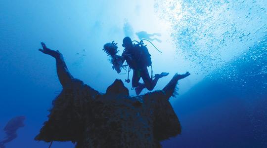 The statue of Kristu tal-Baħħara now stands on the seabed at Qawra point.