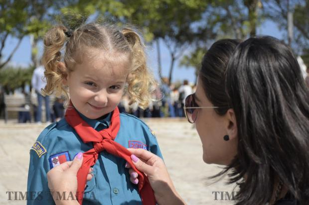 A Mother arranges her daughter's scarf during the annual Scout and Girl Guides Parade started held in Valletta on April 23. Photo: Mark Zammit Cordina
