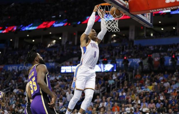 Oklahoma City Thunder guard Russell Westbrook (0) dunks the ball as Los Angeles Lakers guard Reggie Bullock (35) looks on during the second half at Chesapeake Energy Arena. Oklahoma City won 119-103. Mandatory Credit: Alonzo Adams-USA TODAY Sports
