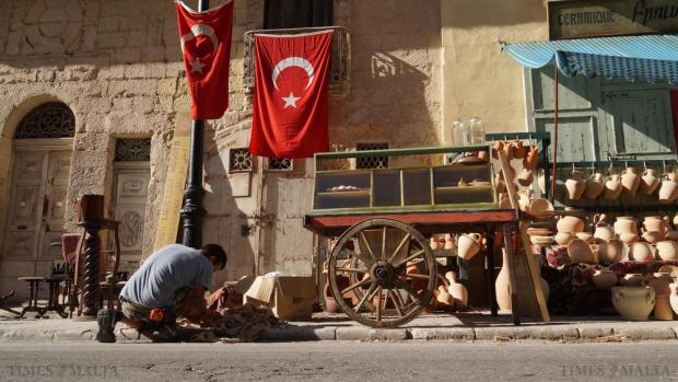 "A set dresser prepares a location for shooting of ""The Promise"", starring Christian Bale in Valletta on October 17. The film is said to focus on a love triangle, set against the tragic backdrop of the last days of the Ottoman Empire. Photo: Steve Zammit Lupi"