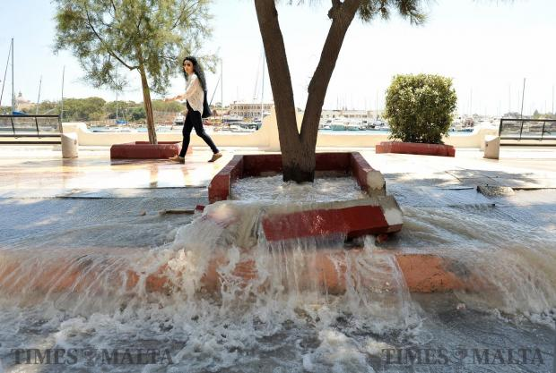 Water gushes out from beneath the Gzira promenade on May 24. Photo: Chris Sant Fournier