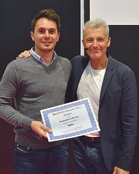 Nicolas Sancho, senior manager MICE – UK & Ireland, receiving the runner-up award from Paul Rose, BBC presenter and explorer.