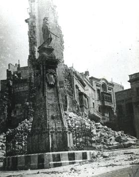 History in ruins: the medieval watchtower reduced to rubble during World War II, with the Victory Monument standing defiantly in Vittoriosa'scentral square.
