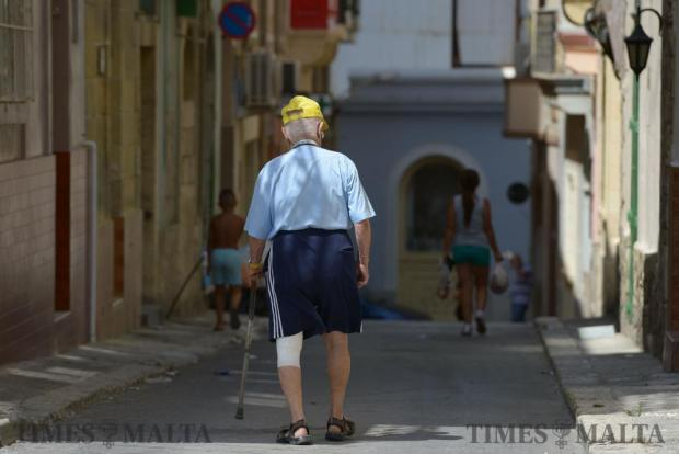 An elderly man works through the streets of Cospicua on August 23, as Valletta and the Three Cities are experiencing a residential rebirth, bridging the old with the new is pushing up housing prices, which risks locking the locals out of their birthplaces. Photo: Matthew Mirabelli