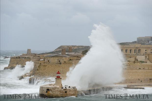 A large wave crashes over the breakwater in the Grand Harbour on December 21. Photo: Matthew Mirabelli
