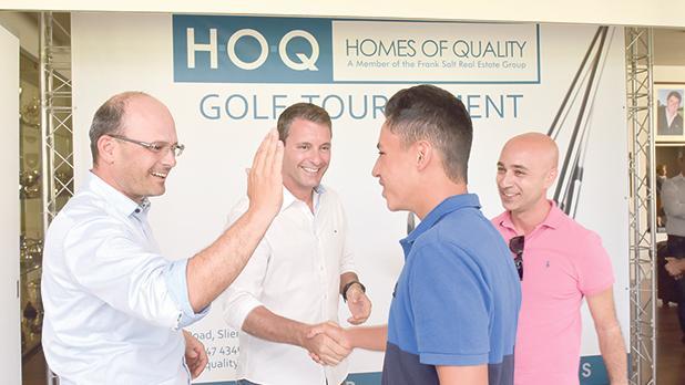 From left: Thomas Jacobsen, Darren De Domenico and Alex Papagiorcopulo congratulating Finley Gratil.